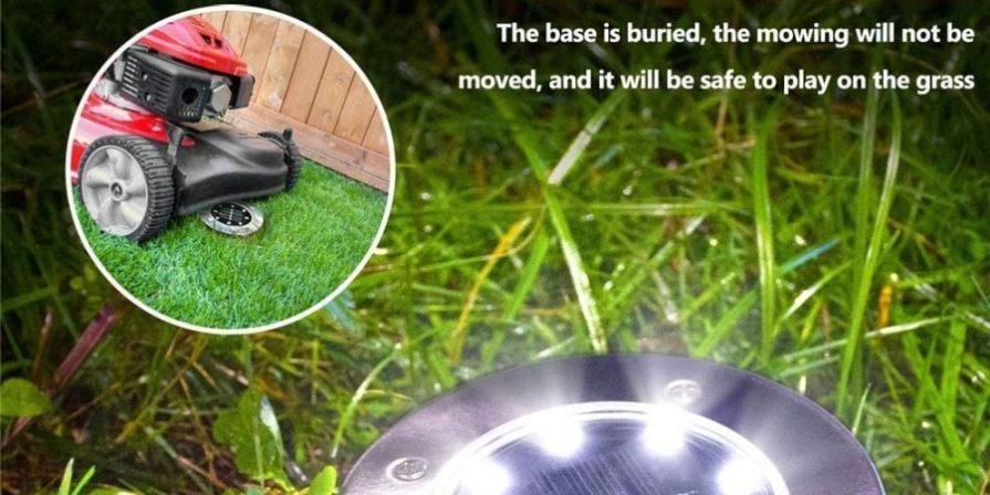 Lawn mower running over a solar disk light.