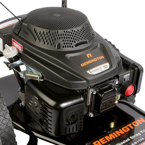 A close-up of a Remington wheeled string trimmer's black and orange gas-powered engine.