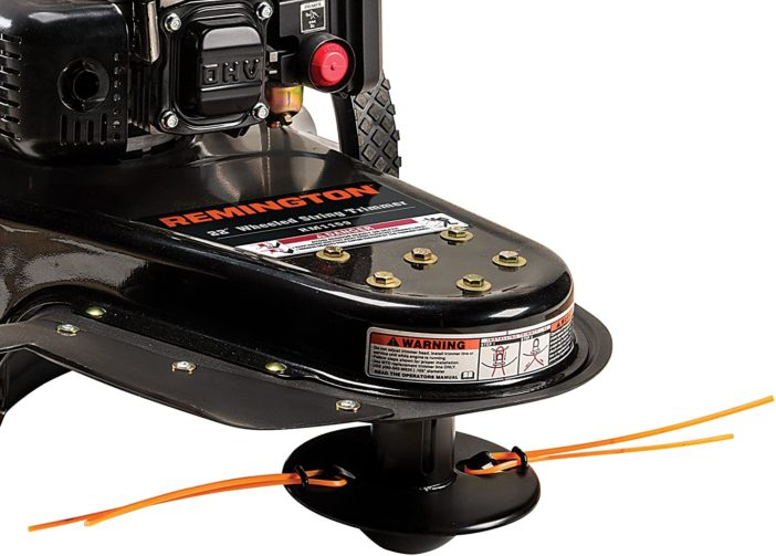 A shiny black dual-line string trimmer head with ornage line.