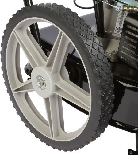 A grey and black high-end Remington string trimmer wheel with a clean white background..
