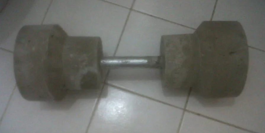 a concrete dumbbell
