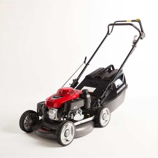 A grey and red Honda walk-behind lawn mower with a grey and black hopper attached.