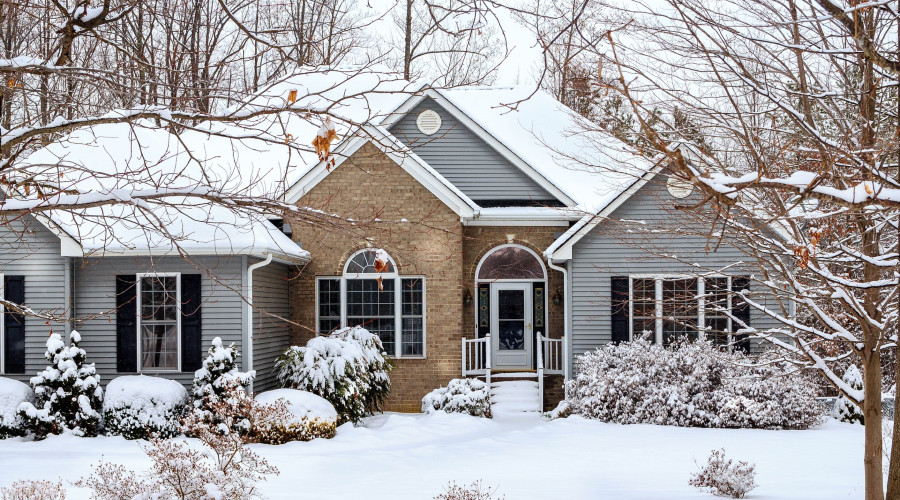 home covered in wintry snow