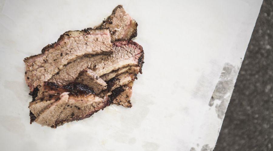 Sliced beef brisket on butcher paper.