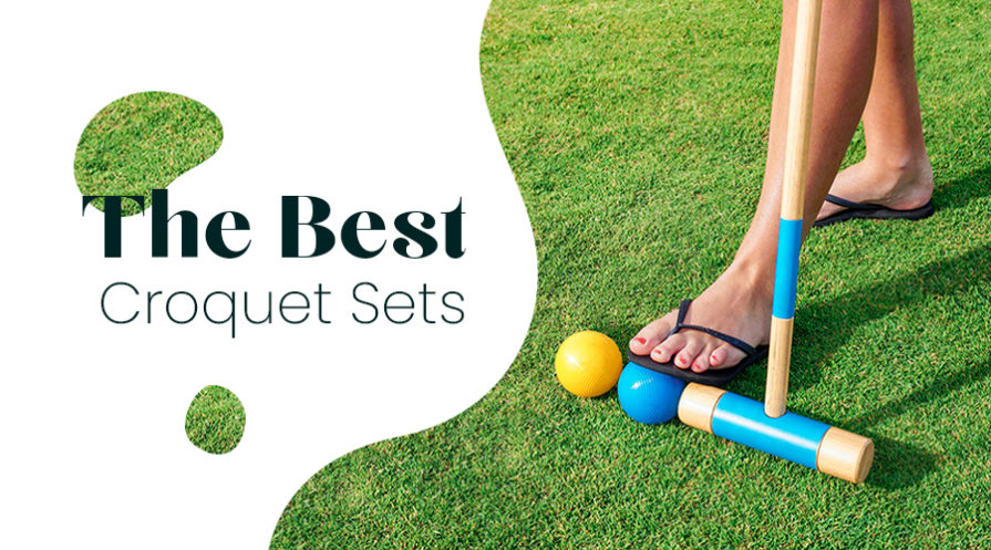 Woman's foot with croquet racket and ball on lawn.
