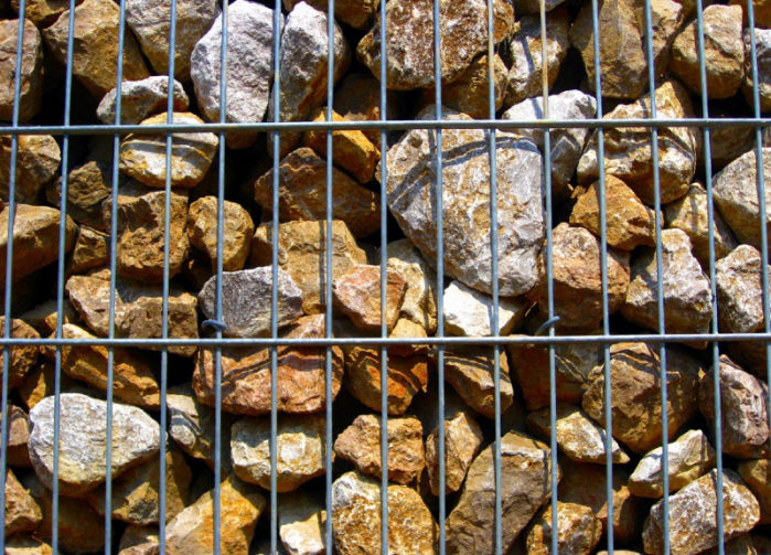 metal fencing filled with rocks