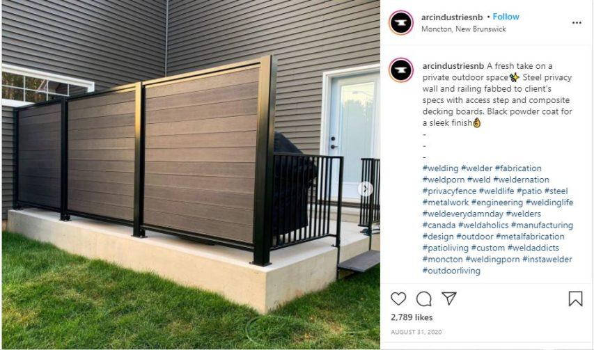 Custom composite decking privacy screen set on concrete patio