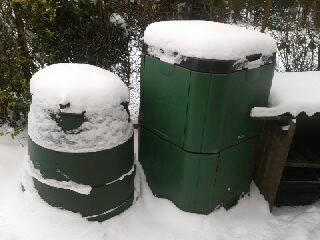 Three Compost Bins Covered In Snow
