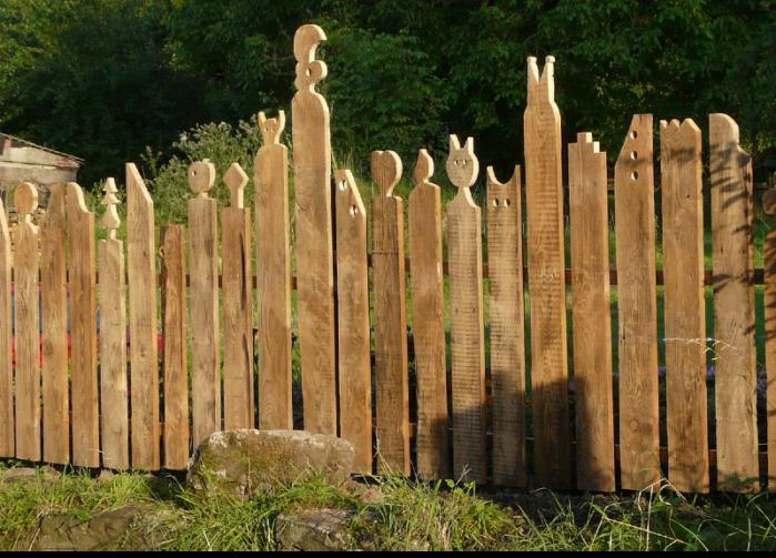 uniquely cut wooden fence posts