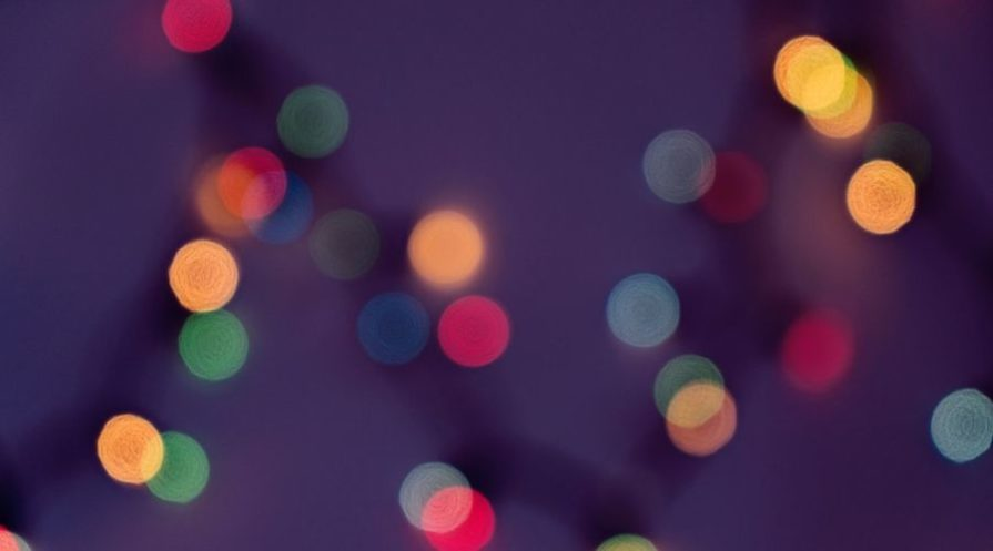 Abstract bokeh of blurred colorful fairy lights.