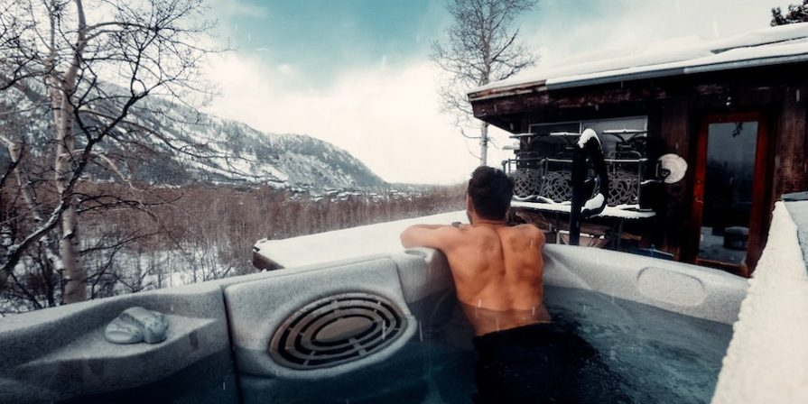 Man In Hot Tub In The Snow