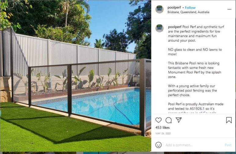 Pool surrounded by mesh fence with steel panel fence at back