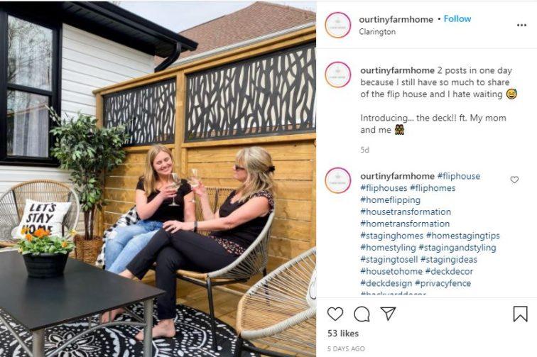 women drinking wine on a deck
