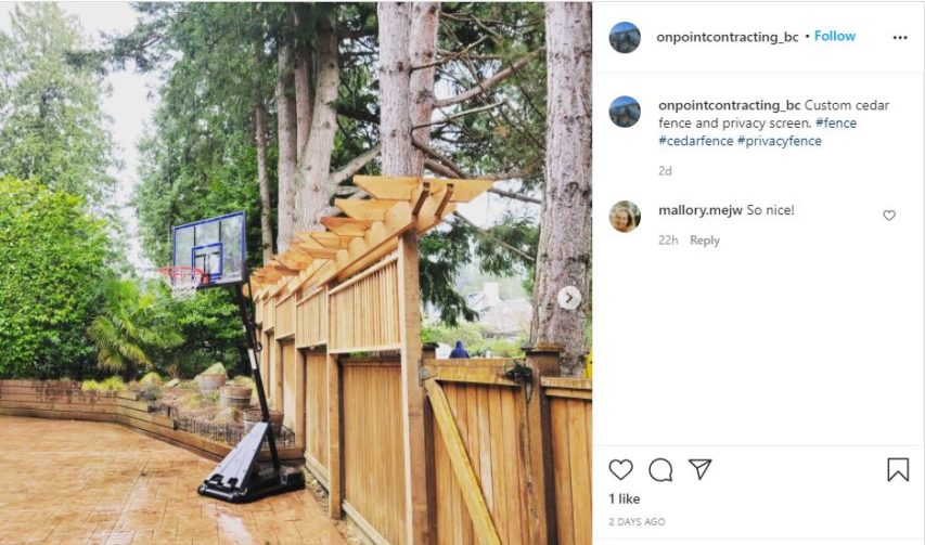 Pergola style privacy fence along treeline