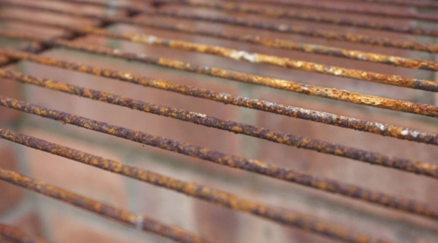 A close-up photo of rusty BBQ grill grates.