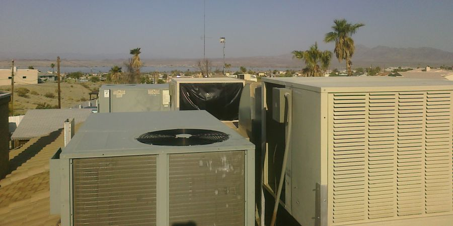 Evaporative swamp coolers sitting on top of a house in Florida.