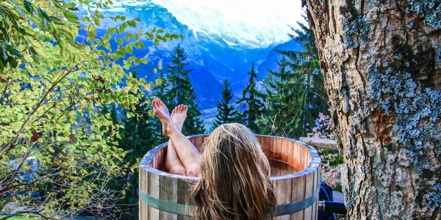 Woman In Wooden Hot Tub In The Woods