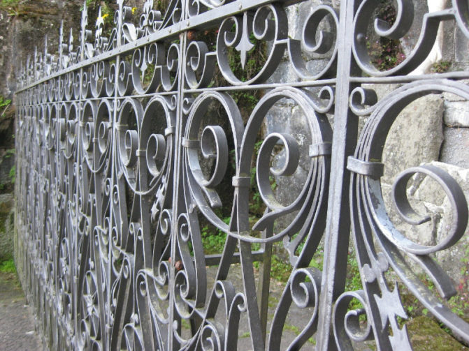 close up of wrought iron fence