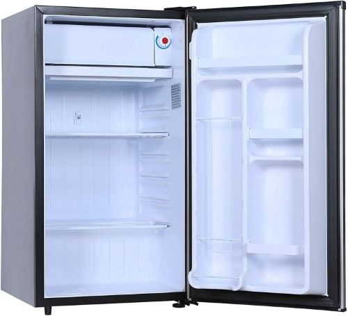 An empty open stainless-steel compact refrigerator.