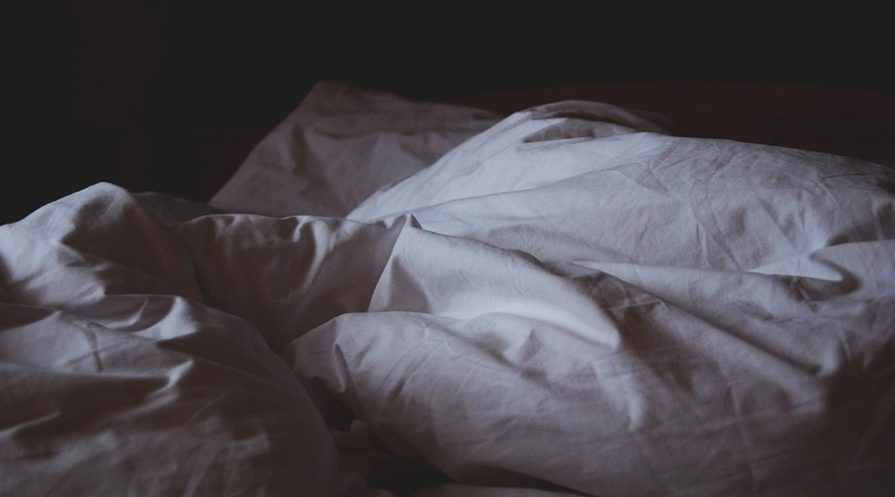 Breathable sheets crumpled up after a good night's sleep.