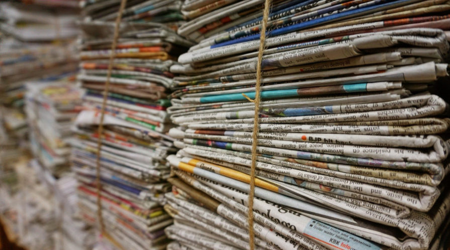 stacked and bundled newspapers