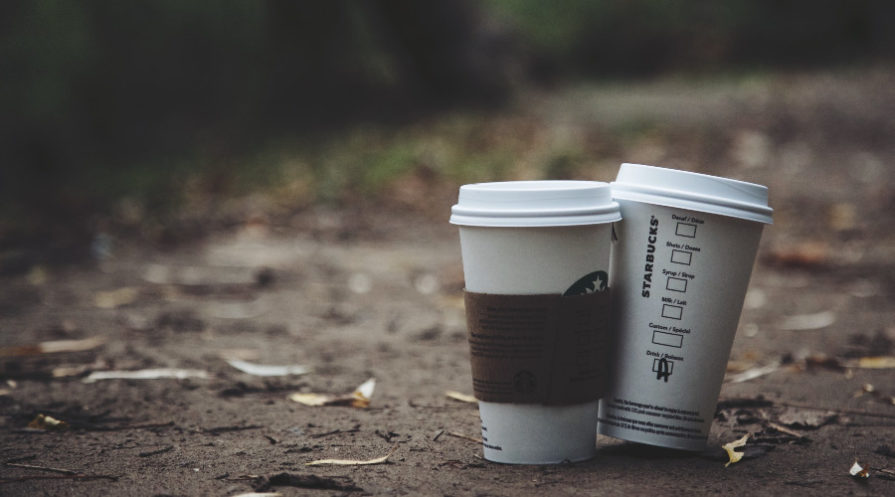 paper cups sitting on path