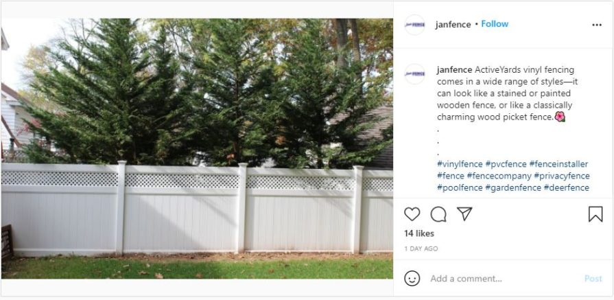 solid white vinyl fence panels with decorative top against treeline