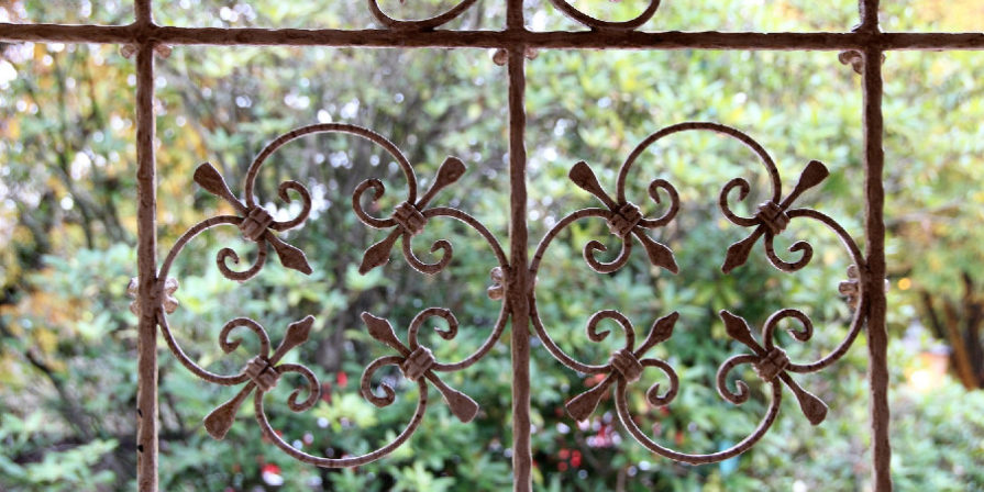 close up of wrought iron fence work