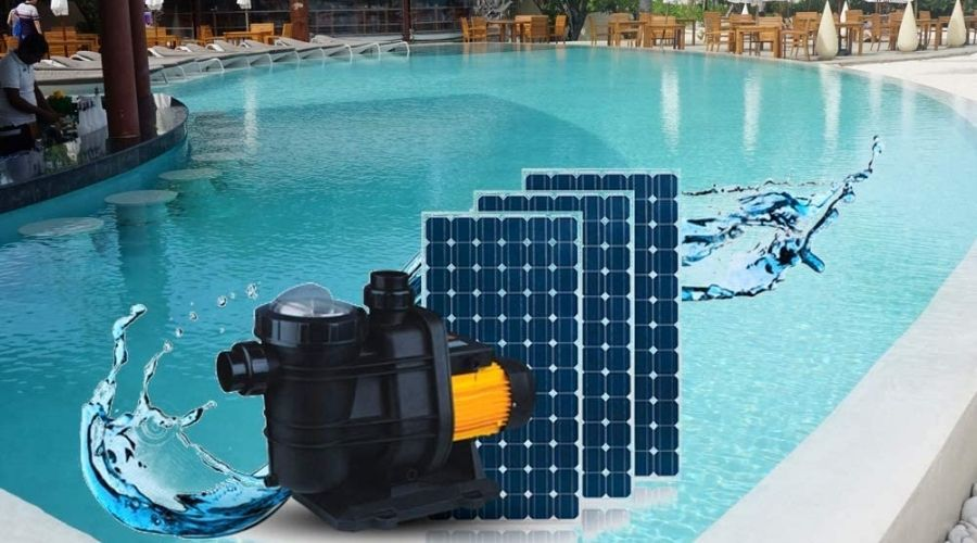A black and orange pool pump and three solar panels sitting in front of an image of an inground pool with chairs, tables and loungers in the distance