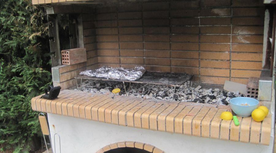 Homemade BBQ grill built from bricks.