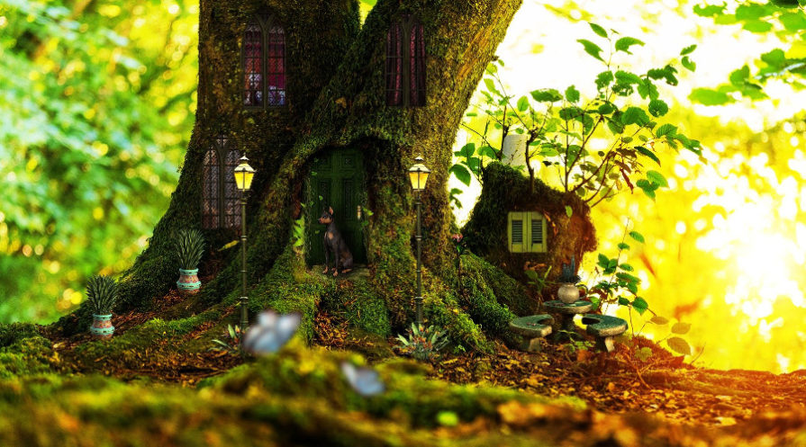 Tree trunk with tiny lanterns, doors, and buildings surrounding, indicating a fairy house