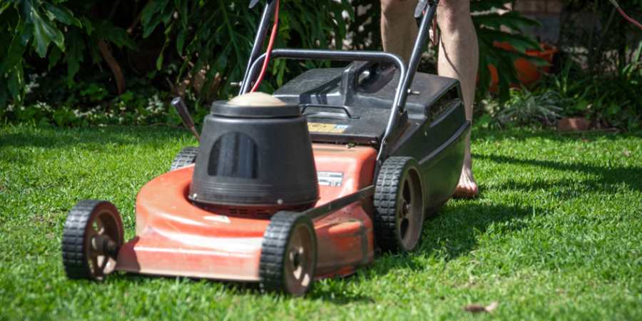Gas Powered Lawn Mower Mowing Grass