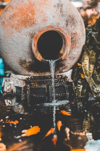 terracotta pot waterfall fountain into koi pond