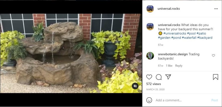 Molded concrete waterfall with plants around