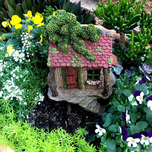 Fairy garden house with stairs leading to front door