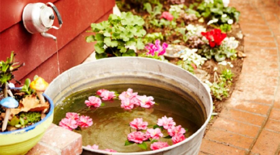 small farmhouse side yard garden teapot fountain