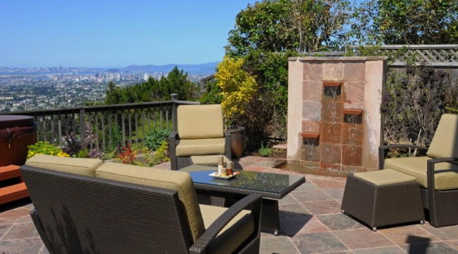 mid-sized classic backyard tile patio fountain