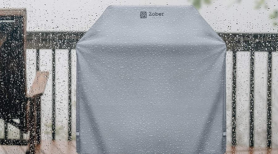 Zober grill cover seen standing in the rain through a glass window.