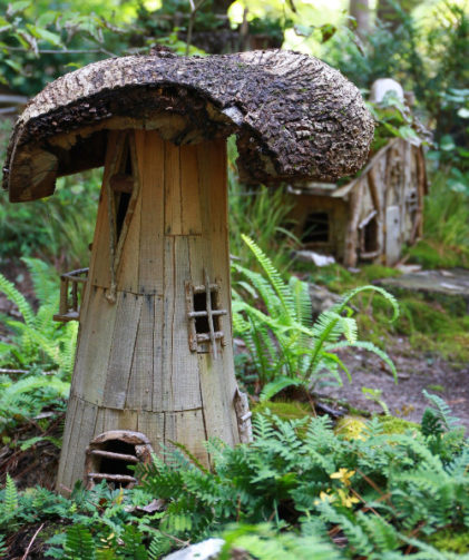 fairy house made of bark and twigs to look like mushroom