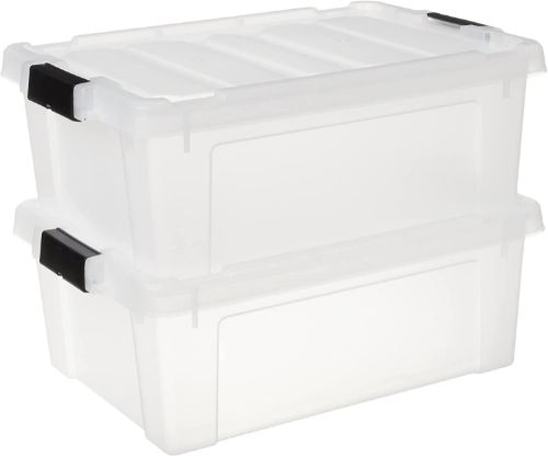 Two clear plastic heavy-duty storage totes sitting one on top of the other