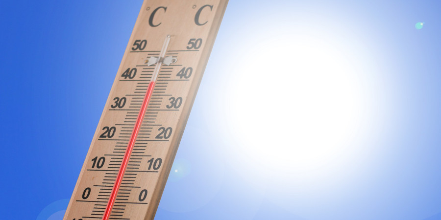 thermometer on blue and white background