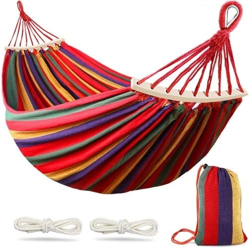 A red, purple, yellow and green striped cotton hammock with curved wooden bars, a striped stuffed sake and 2 white ropes.