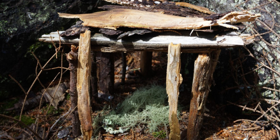 fairy house made of rough wood and twigs