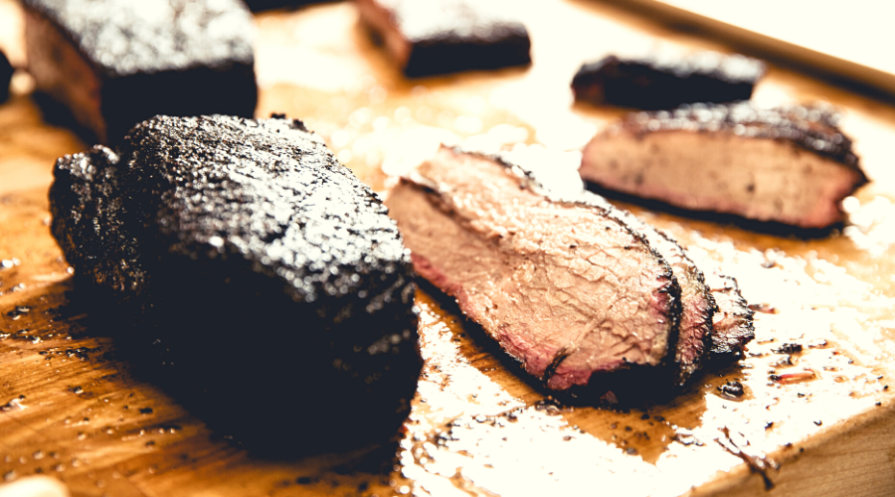 smoked brisket on a cutting board