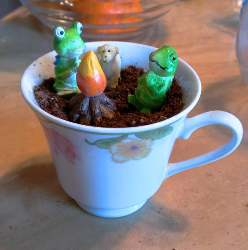 resin miniature frog, turtle, and dog around fire in teacup