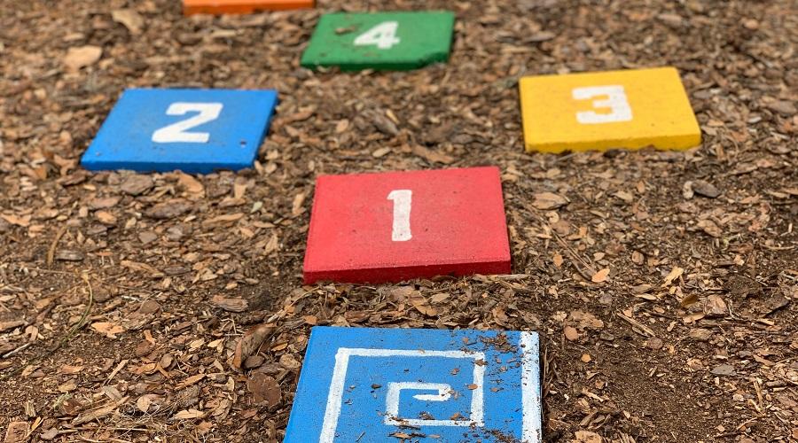 Kids colored bricks at playground.
