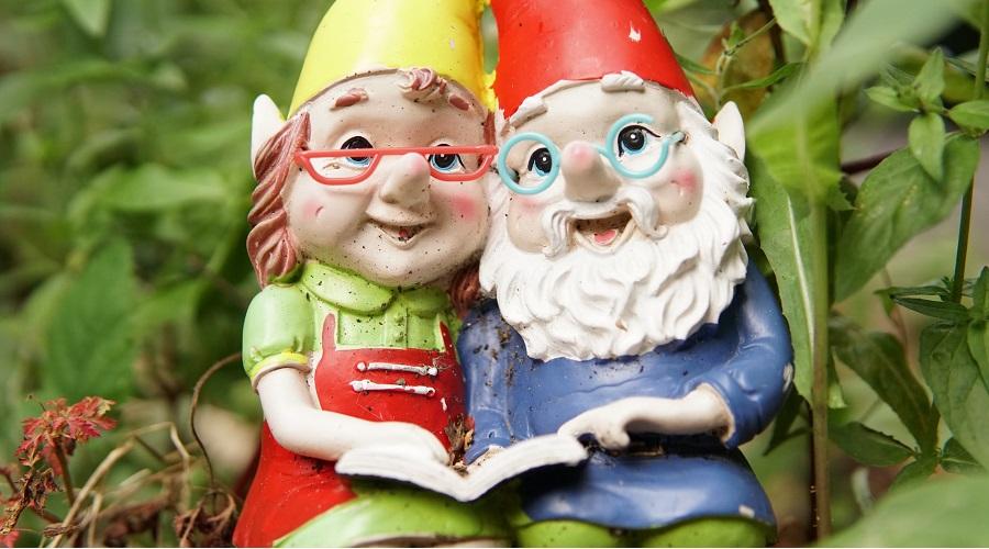 a gnome couple reading a book