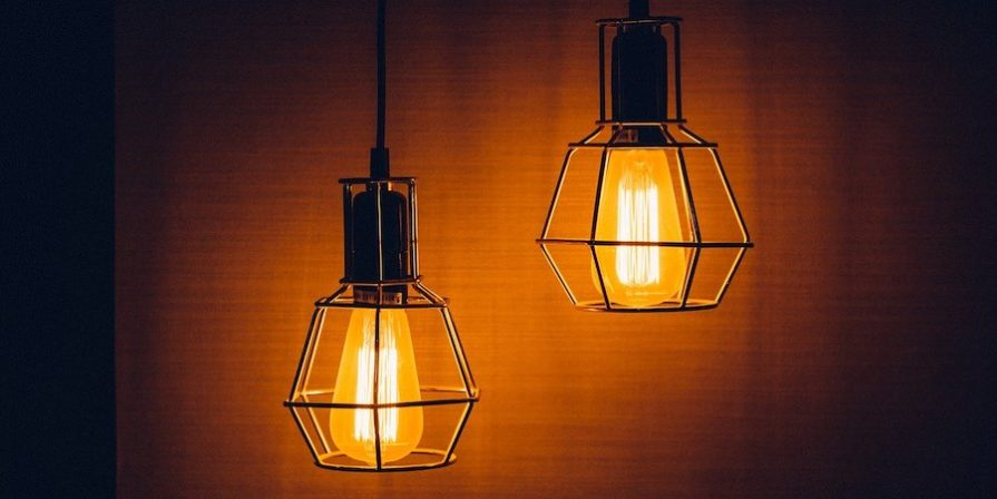 Two Lightbulbs In Wire Cages