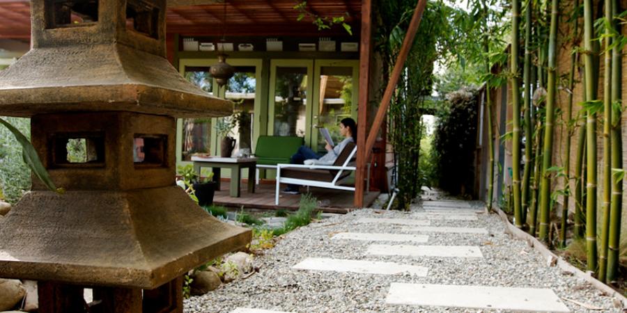 Person Relaxing in Zen Garden