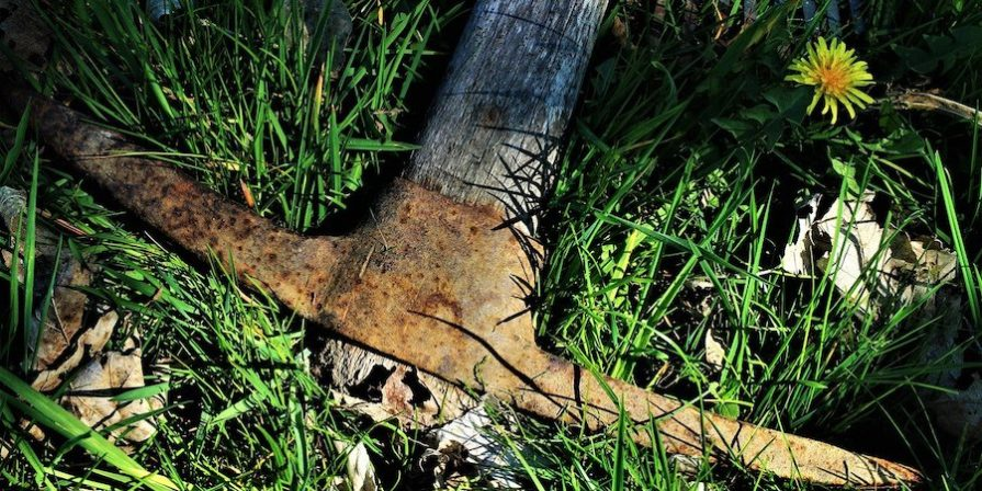 Pick Axe On The Grass
